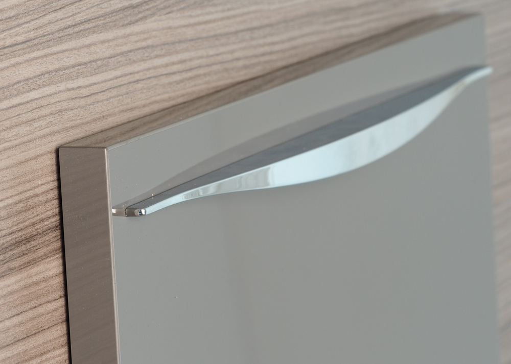 Curved Chrome handle on a mid grey door